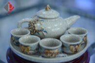 Bộ ấm trà cúng 5 chén men rạn nổi đắp hoa đào